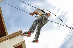 Man Wearing Harness Going Down Building stock image