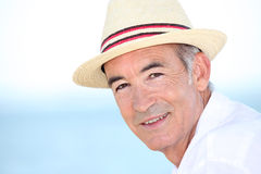 Man wearing hat by coast Royalty Free Stock Photo