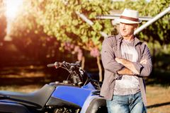 Man standing next to truck in vineyard Stock Photography