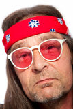 Man Wearing Headband and Rose Colored Glasses Stock Image