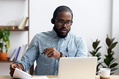 Man wearing headphones learn foreign language indoors royalty free stock images