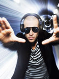 Man Wearing Headphones And Sunglasses With Hands Out Royalty Free Stock Photography