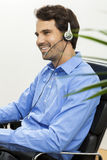 Man wearing headset giving online chat and support Stock Images
