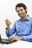 Man wearing headset giving online chat and support Stock Image