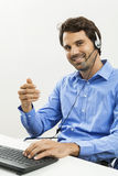 Man wearing headset giving online chat and support Royalty Free Stock Images