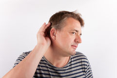 Man wearing hearing aid Stock Images