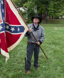 Man wearing historical costume holding Confederate flag Stock Images