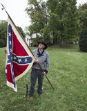 Man wearing historical costume holding Confederate flag. Warrenton, Virginia, USA-October 1, 2016: Man wearing historical costume holding Confederate flag at the Royalty Free Stock Images