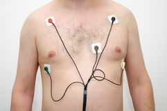 Man wearing holter monitor Stock Images