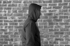 Man wearing hood ,black and white Stock Images