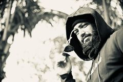 Man wearing a hood dress unique photo. A bearded man wearing black hood dress standing in a place unique black and white photo stock photos