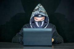 Man wearing hood on looking dark Stock Photo