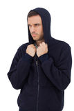 Man wearing hooded jacket Stock Images