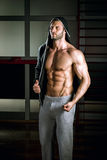 Man wearing hoodie posing in gym Stock Images