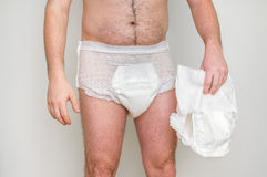 Man wearing incontinence diaper Royalty Free Stock Image