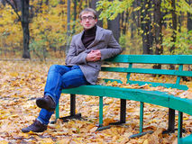 Man wearing a jacket. A man wearing a jacket with glasses in autumn Stock Photos