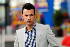 Man wearing jacket and shirt in urban background Stock Photo