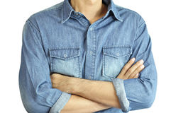 Man wearing jean shirt crossing his arms Stock Image