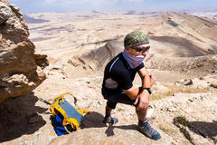 Man wearing keffiyeh standing desert mountain. Royalty Free Stock Photography