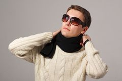 Man wearing knitted scarf with sunglasses Stock Image
