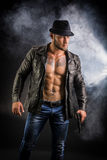 Man wearing leather jacket on naked muscular torso Stock Photos