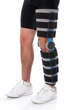 Man wearing a leg brace royalty free stock image