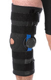 Man wearing a leg brace Stock Image