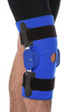 Man wearing a leg brace. Over white royalty free stock photography