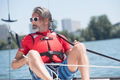 Man wearing life jacket. Sailing royalty free stock photo