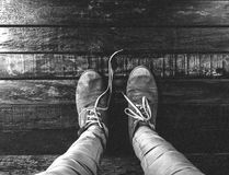 Man Wearing Low Top Shoes Standing on Wooden Plank in Grayscale Photo Stock Photography