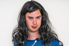 Man wearing makeup and dress looks like as a woman Stock Photos