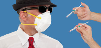 Man wearing a mask being vaccinated stock images