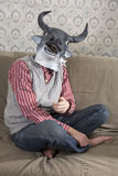 Man wearing mask of bull Royalty Free Stock Images