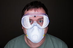 Man wearing a mask and goggles Royalty Free Stock Photos