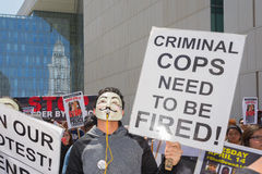 Man wearing mask holding a sign Stock Photography