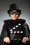 The man wearing mask with movie board. Man wearing mask with movie board Royalty Free Stock Photography