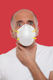 Man wearing a mask protection Stock Photo