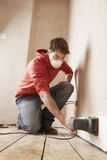 Man Wearing Mask While Sanding Wall Stock Images