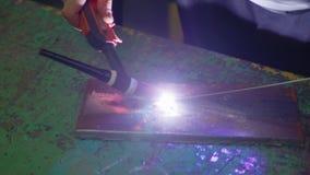 Man wearing mask welding in a workshop. Metal workers use manual labor. Skilled welder. Welder is welding the stainless