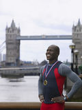 Man Wearing Medal Against Tower Bridge In England Royalty Free Stock Images