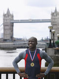 Man Wearing Medal Against Tower Bridge In England Stock Photography