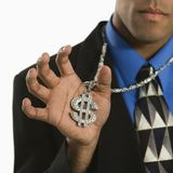 Man wearing money sign. African American man wearing necklace with money sign stock images