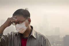 Man wearing mouth mask against air pollution Stock Images
