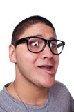 Man Wearing Nerd Glasses. A goofy man wearing trendy nerd glasses isolated over white with a funny expression on his face Royalty Free Stock Image