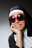 The man wearing nun clothing in funny concept Stock Image