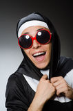 The man wearing nun clothing in funny concept Stock Photo