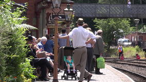 Man wearing old style clothes and stream train station 4K. Traditional scene of the steam age 4K stock video footage