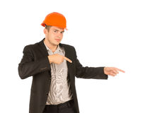 Man Wearing Orange Hard Hat Pointing to the Side Royalty Free Stock Images