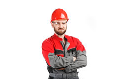 Man wearing overalls with red helmet Stock Photos
