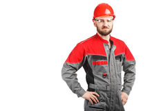 Man wearing overalls with red helmet Royalty Free Stock Photo